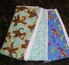 Assorted (boy and girl print) baby burb cloths.  Nicely padded material to absorb anything baby spits up while burping.