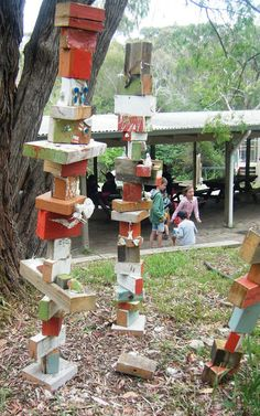 let the children play: outdoor sculptures with kids..have scrap boards in the art area. When a child paints or draws on a piece add it to the sculpture