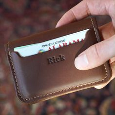 The Gates Personalized Fine Leather Bifold Money Clip Wallet is part of fitness The Gates Wallet is designed to do more than a typical front pocket wallet! Crafted from our Doolittle framework i - Leather Wallet Pattern, Handmade Leather Wallet, Leather Card Wallet, Money Clip Wallet, Things To Buy, Stuff To Buy, Leather Projects, Leather Accessories, Leather Tooling