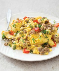 Serves 4 to 6 Ingredients: 8   ounces ground pork 1   garlic clove, minced 1   teaspoon minced fresh thyme or ¼ teaspoon dried 1   teaspoon minced fresh sage or ¼ teaspoon dried Kosher salt and pepper Pinch red pepper flakes 12   large eggs 2   tablespoons water 3   tablespoons ghee 1   red bell pepper, stemmed, seeded, and cut into ½-inch pieces 3   scallions, white and green