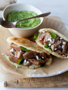 No one will pass up these Venezuelan arepas filled with carnitas and guasacaca. Trust us.