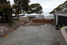 Driveway looking down to house during construction. Conningham Residence. Construction work for David Travalia Architect. (New House) 2011/12.