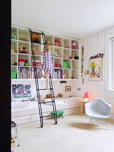 Use a whole wall for creating a building from shelves. Install a sliding ladder, and you will create an imaginative solution for storing children's toys.