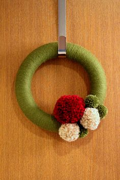 Pom Pom wreath simple and effective with wool wound wreath ring.