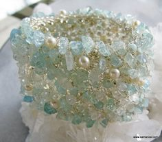 Knitted wide cuff with silver plated wire and freshwater pearls, aquamarine and apatite chips and Amazonite round faceted beads. The cuff is doubled, the inside knitted with silver beads knit into the fabric.                   2 inches wide            $75.00