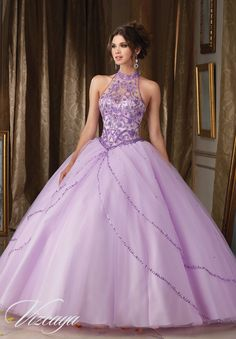 Stunning and gorgeous, Mori Lee Vizcaya Quinceanera Dress Style 89114 is sure to light up the room during any girl's Sweet 15 party. Made out of tulle, this Quince dress features a high halter sheer i