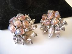 www.etsy.com/shop/FindCharlotte Excited to share the latest addition to my #etsy shop: Crown Trifari Etoile Earrings Pink Lava Cabochon Clip on Earrings Designer Signed Cluster Pink Blue Rhinestone Glass Cabochon Statement http://etsy.me/2nEnkWO #jewelry #earrings #pin