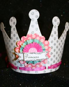 princess party hat.  I thought it'd be fun to come up w/a template like this and let the girls decorate their own princess hat??