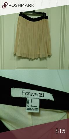 Forever 21 Nude Pleated Skirt Like new. Worn once. Hits just above the knee. Same fit as cover photo, but actual skirt for sale is NOT METALLIC! Forever 21 Skirts