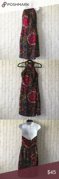 """TRINA TURK 4 SILK FLORAL HALTER DRESS Gorgeous fully lined Trina Turk size 4 halter dress. Flower button detail. 100% silk . Approx 39"""" long 16 1/2 inch bust 14 1/2 inch waist 19 1/2 inch Hip laying flat. Preloved condition. Some seams show a little wear but has lots of wear left! Trina Turk Dresses"""