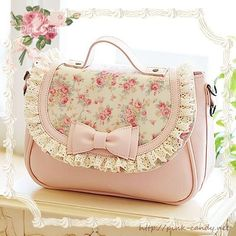 Floral pink clutch with bow a d ribbon