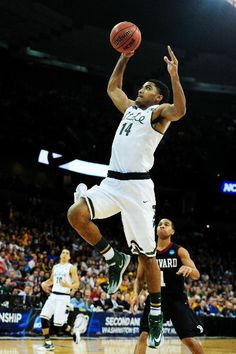 Gary Harris #14 of the Michigan State Spartans goes up against the Harvard Crimson in the first half during the Third Round of the 2014 NCAA Basketball Tournament at Spokane Veterans Memorial Arena on March 22, 2014 in Spokane, Washington. (Photo by Steve Dykes/Getty Images)