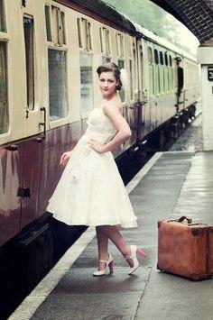 1940's bride waiting at train station