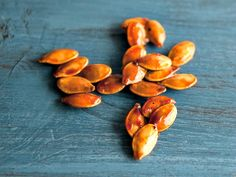 Easy candied pumpkin seeds made with organic coconut oil, maple syrup, and sea salt.