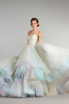 Rainbow ideas for your wedding day: http://www.weddingandweddingflowers.co.uk/article/1420/wedding-moodboard-rainbow-ideas-for-your-celebration Ombre wedding dress