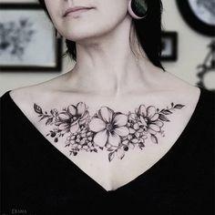 Delicate flower tattoo on the chest #DianaSeverinenko #floral #flower #blackwork