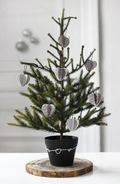miniature christmas tree, love the base and delicate ornaments