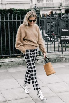 tan fuzzy sweater + black and white checkered trousers + silver metallic ankle boots