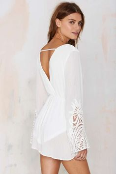 The Sasha Crochet Romper is a wisp of summer perfection in crisp white.