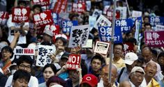 People protest outside the parliament building in Tokyo against Japanese prime minister Shinzo Abe's move to change the country's security policy. Photograph: Thomas Peter/Reuters