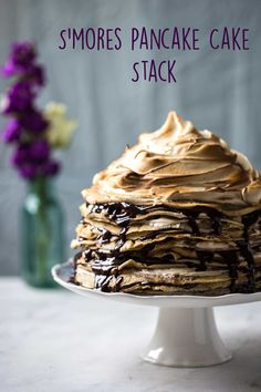 The most epic pancake cake stack ever! Layers of rich chocolate sauce, vegetarian marshmallow frosting and classic pancakes. This is one to share with the people you REALLY love