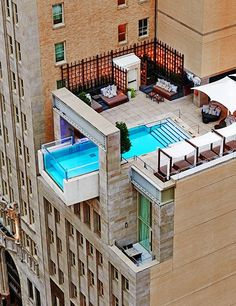 The Joule Hotel's sleek cantilevered rooftop pool provides unforgettable views of Dallas | archdigest.com