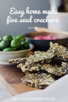 Healthy and moreish home made five seed crackers are a tasty snack by themselves or with your favourite dip, perfect in school lunchboxes or to serve alongside drinks. #vegan #glutenfree #keto #paleo