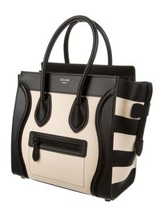 Phoebe Philo Collection. White leather Céline Micro Luggage Tote with black leather trim, striped details at sides, dual top handles, exterior zip pocket at front, black leather interior lining, three pockets at interior walls; one with zip closure and zip closure at top. Includes tags and dust bag. Shop Céline handbags on sale at The RealReal.