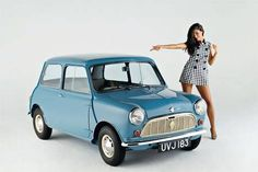 Classic Mini Cooper in a Sky Blue with a 70's stylish model girl.