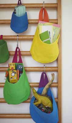 Easy to hang from the sewn loop, STICKAT space-saving baskets help to keep your children's belongings organized.