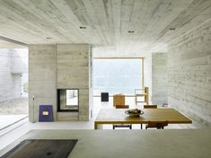 This concrete house in Sant Abbondio, Switzerland was designed by Wespi de Meuron Romeo Architetti. The house is surrounded by a Architecture Résidentielle, Contemporary Architecture, Architecture Wallpaper, Concrete Interiors, Concrete Houses, Fireplace Design, Minimalist Interior, Minimalist House, Sweet Home