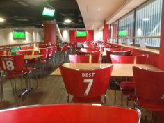 Manchester United cafe has seating that makes it look like customers are wearing uniforms