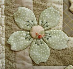 flower & stamen...  cute buttons in center... maybe not on bed, but table runner for whimsy.