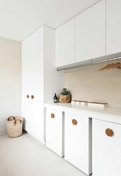 Design Idea – Oversized Wood Knobs On Cabinets - This modern house features oversized natural wood door handles on all of the cabinets throughout th - Wood Door Handle, Barn Door Handles, Cabinet Door Handles, Wooden Handles, Laundry Room Cabinets, Storage Cabinets, Kitchen Cabinets, Cupboards, Utility Room Designs