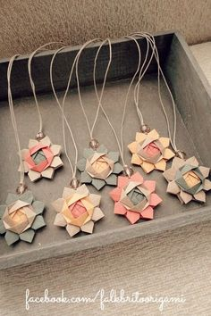 origami flower pendants  ... flower, bead & cord ... luv the soft colors ...