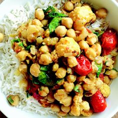 Toasting the curry powder with other aromatic ingredients before adding the liquid intensifies the flavor of this quick take on chana masala. You can roast the cauliflower and tomatoes a couple days ahead; cool, cover, and refrigerate until ready to use.