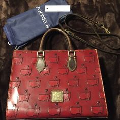 Dooney & Bourke Masters Edition Purse This is a highly collective Dooney & Bourke Purse. Dooney makes limited edition purses for the Masters Tournament every year that is held at the Augusta National. The only way to get this purse is to attend the prestigious tournament. Dark Burgundy, not red. Some slight wear. 2014 edition. Dooney & Bourke Bags