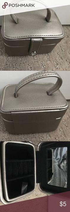 Jewelry case Can be used for travel.  Small.  Very fashionable.  Never been used. A little dusty, but can be fixed. Jewelry