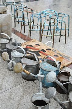 antique watering cans!