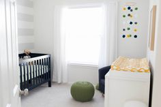 Bright white #nursery with thoughtful pops of color.