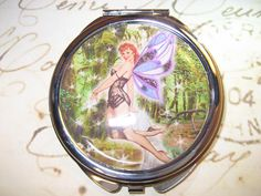 Compact Mirror with PinUp Fairy by RubysRibbonsandBows on Etsy.