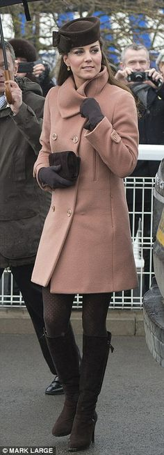 pretty dusky pink wool coat by Joseph paired with a bow-trimmed felt hat by heritage British brand Lock & Co -Dailymail