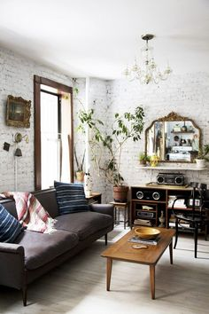 Collected living room with white painted exposed brick