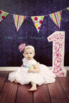 First Birthday Girl photo, big number one, purple backdrop, by Natalie Eberhard Photography, Nevada, Missouri