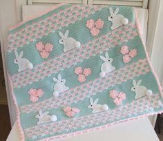 Crochet Pattern for a Bunny Baby Blanket.  Pattern pack includes instructions for a boy bunny blanket and a girl bunny blanket. $6.99 http://crochetvillage.com//