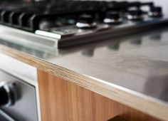 Brooklyn Townhouse Remodel Stainless Kitchen Counter Detail Fernlund and Logan Matthew Williams Plywood Countertop, Plywood Kitchen, Kitchen Wood, Stainless Steel Countertops, Stainless Steel Kitchen, Cute Kitchen, New Kitchen, Kitchen Decor, 10x10 Kitchen