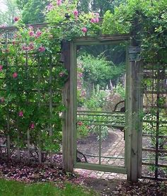 Old screen door used as a garden gate. Perfect repurpose and oh so beautiful.