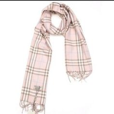 ⚡️Final price ⚡️Pink blueberry plaid scarf Pink and brown Burberry plaid scarf. Has some tiny holes in it, more pictures coming soon, trade value is $150 Burberry Accessories Scarves & Wraps