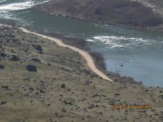 PT MARCH 2015 KUNA IDAHO. DEDICATION POINTE, BIRDS OF PREY, SNAKE RIVER. ROCKS IN THE MIDDLE OF THE RIVER.