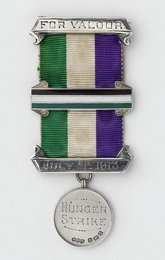'Nellie Hall's hunger strike medal, July 21st 1913'. Nellie Hall (given name Emmeline) (b. 1895) British suffragette + god-daughter of Emmeline Pankhurst, after whom she was named. Nellie's involvement in the Women's Suffrage movement was influenced by her parents, particularly her mother Martha, who was one of the original 6 women who formed the WSPU in 1903.